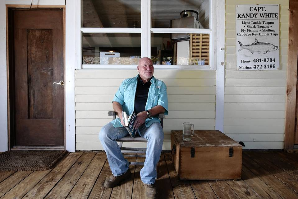 Sanibel Rentals, 4-24-15, Randy Wayne White on the front porch of his Pine Island, Fla., home that he purchased in the late 1980s for about $225,000. PHOTO- ALEXIA FODERE FOR THE WALL STREET JOURNAL.